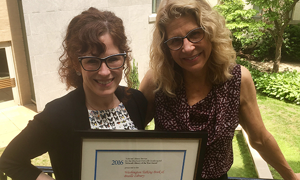 Cindy Aden and Danielle Miller with award