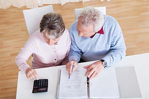 couple looking over financial documents