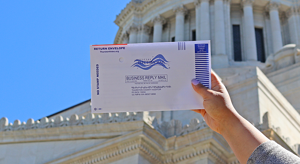 Ballot return envelope in front of the legislative building