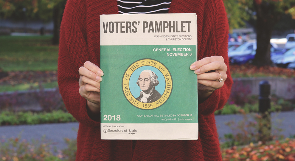 Picture of a person holding the Washington state Voters' Pamphlet