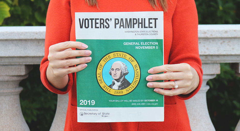 Picture of the person holding the voters' pamphlet