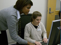 Computer Lab - Librarian Eura teaches a WTBBL patron in the Jan Walsh Computer Lab