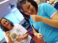 WTBBL patron and her mother experience the fragrant plants at WTBBL's Youth Services Open House