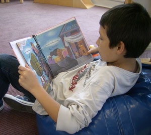 Youth reading in Orrico Children's Room