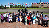 Korean War veterans with South Korea's Consul General at the Korean War Memorial in Olympia.