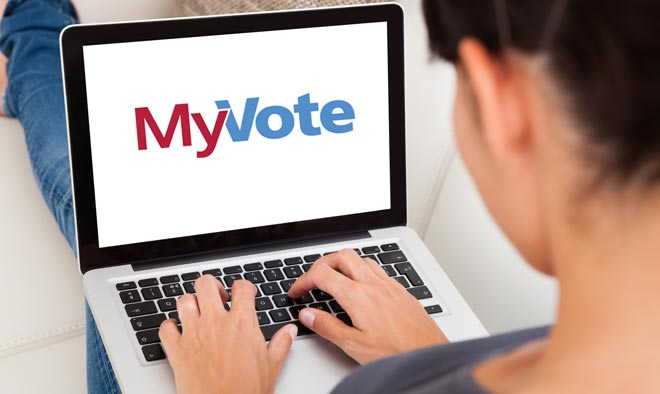 woman holding laptop with MyVote logo