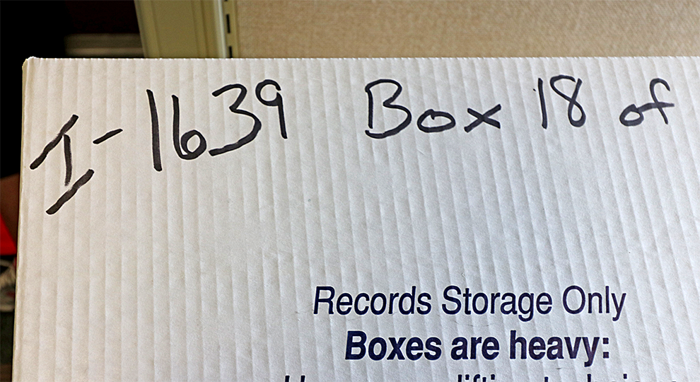 Box with the world I-1639 written on in black sharpie