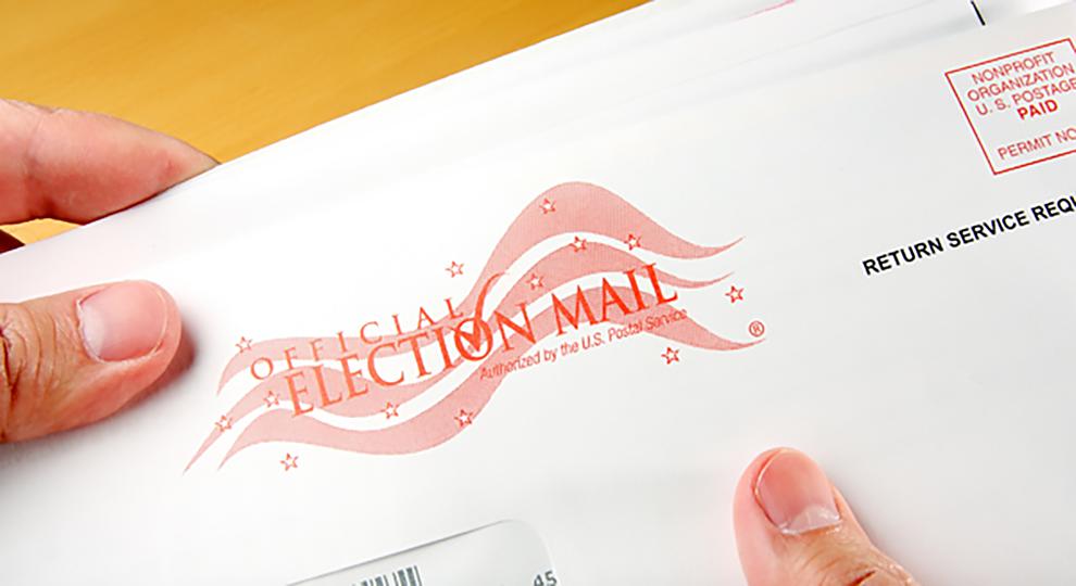 Hand holding a ballot