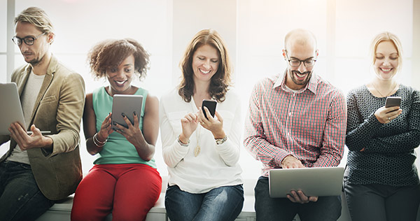 Diverse group of men and women on various mobile devices